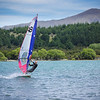 Windsurfing on Dublin Bay Bevin Young<br /> What a beautiful setting for windsurfing. The bright colours of the sail add to the impact of this image and they contrast nicely against the greens in the background and the colour of the water. The windsurfer is well placed within the frame and the fact he is facing the camera adds immensely to this image. Well done!<br /> Honours