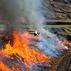 "Controlled burn 	Nick Wallis Novice<br /> 	What a great PJ shot. I love the way you have taken the fire on a diagonal leading into the image and then taking us on to the rolling foothills. This gives us a good idea of where this is happening which is important in a PJ shot. Love the way the helicopter is just ""perched"" on top of the flames. I don't know where you were when you took this but great composition.	HONS"