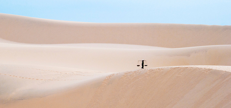 Long way home Tim Pierce A grade<br /> This very simple image has it all, lovely muted colours and soft undulating lines. The placement of the little black figure just tops it off.. Also slight texture in the sand hills adds another dimension.HON
