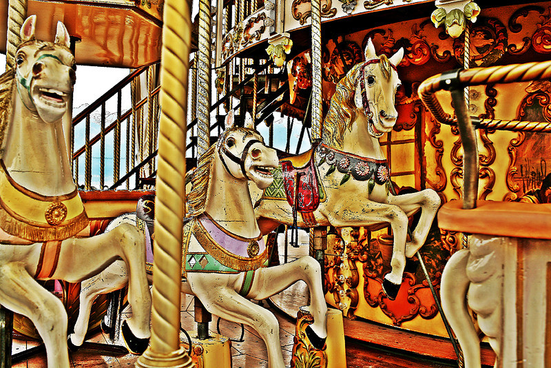 Horse Carousel in Vevey<br /> The image is very colourful and full of interest, however I feel the horse on the left adds nothing to the image as it is not sharp enough, the pole on the left third cuts the image in two and the piece on the right hand side of the frame acts as a block which hinders the eye from easily flowing into the depths of the image. If it weren't for those things I would have happily given this a Merit, but I find they just niggle at me too much. Sorry! Nice try but in A-Grade this is Not Accepted