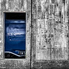 Secret Revealed Tim Pierce A grade<br /> The use of monochrome with a touch of colour works well and I like the contrast between the textures of the wood and the smoothness of the metal. The little doorway/window is well placed within the frame.<br /> Honours