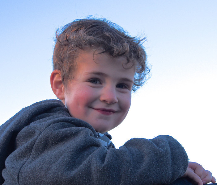 Josh on Top of the World on Dad's Shoulders Heather Macleod B<br /> A great shot in which your model has a delightful expression that brings a smile to the viewer. I'd try lightening the eyes a tad to bring them to life a little more. Great shot.  Honours