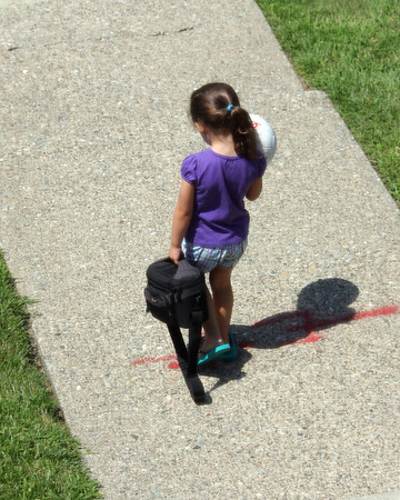 Our little photographer leaving with her camera bag