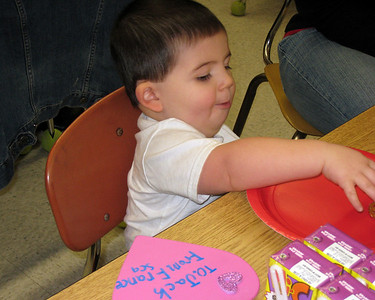 Enjoying myself at the Valentine's party in Mommy's class.