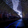A light festival that went on along a newly renovated canal on the North-South running Horikawa street. They had all sorts of sculptures made out of bamboo, and this tunnel that resembles the milky way . The blue streaks in the water are the glowing balls they sent floating down the stream.