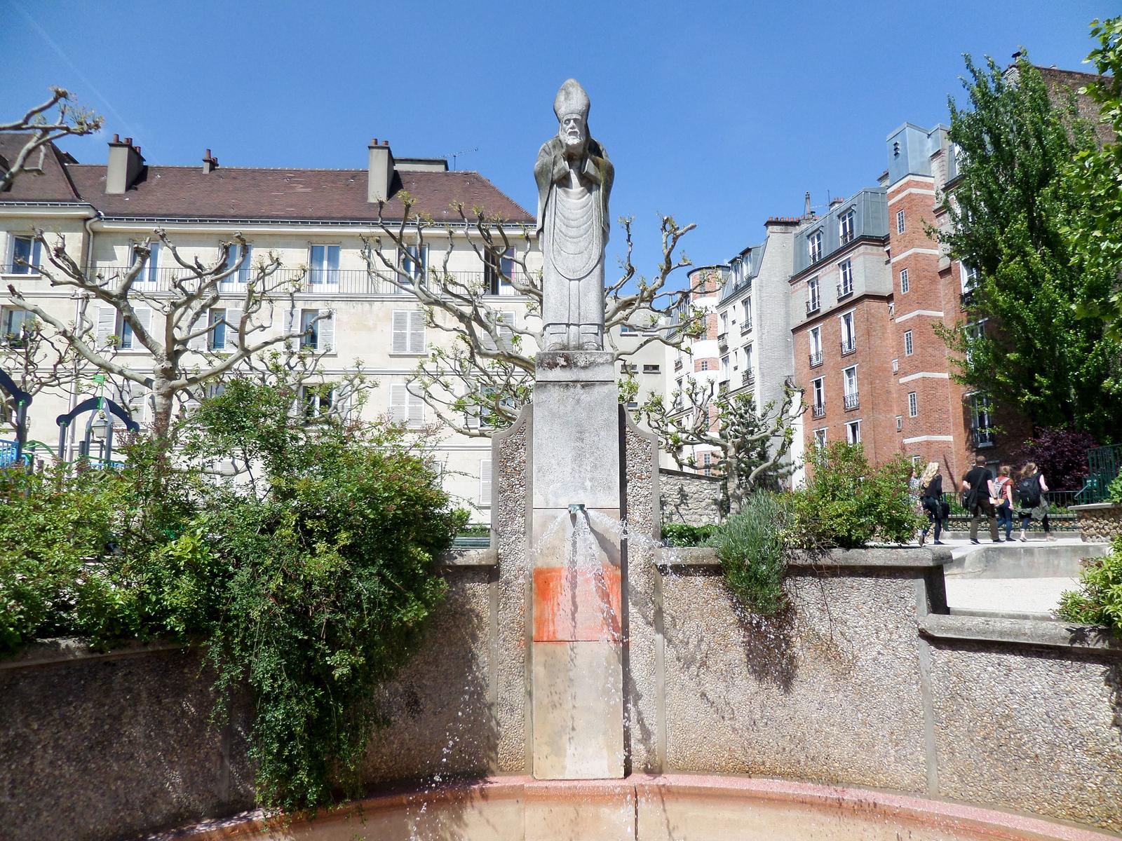 Saint Dennis Statue