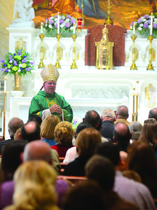 Bishop Joseph P. McFadden speaks to the congregation at St. Joseph Catholic Church on Sunday.
