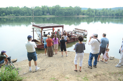 A crowd of spectators gathered Friday afternoon to watch the maiden voyage of The Billy Marks coal dredger in the Susquehanna River.