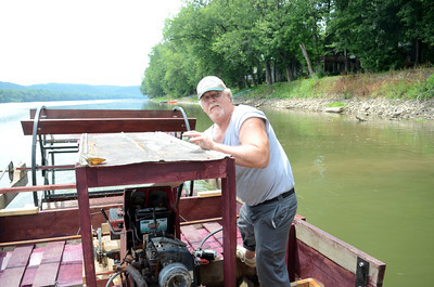 Brad Becker, Danville, tunes the engine of The Billy Marks coal dredger on Friday afternoon while it rides along on the Susquehanna River.