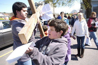 Craig Rinaldi, 14, left, and his brother Joey, 10, Danville, set up a cross at a stop during Friday's crosswalk in Danville.