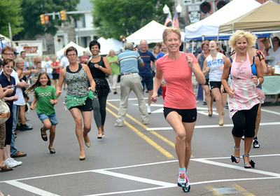 More than a dozen women and men raced along Mill Street in at least three inch heels to raise money for the Danville Area Community Center.
