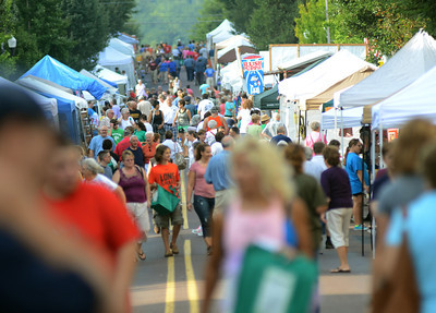 Crowds start to gather early Saturday along Mill Street in Danville for the annual Fall Arts and Crafts Festival.