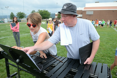 Danville High School junior Jenna Cole, 16, left, gets some instruction from Todd Egger on the marimba during Wednesday mornings practice.