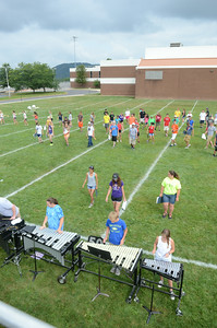 The Danville High School marching band practices their formations on Wednesday morning outside the high school.