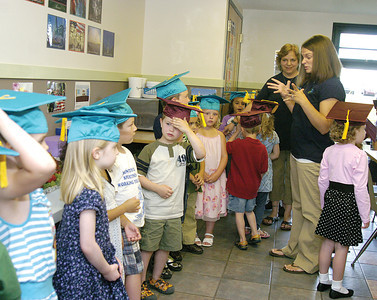 The kids in the Danville Child Development Center preschool graduation line up before the ceremony on Wednesday.