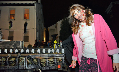Kara Thompson, of Danville, walks with the Creative Attitudes Nail Salon float in the Danville Halloween Parade on Thursday night.