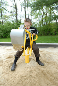 Danville Primary School first grade student Ryan Flatley uses a digger at the PPL Montour Preserve Monday afternoon during a end of year picnic for Life Skills and autistic students.