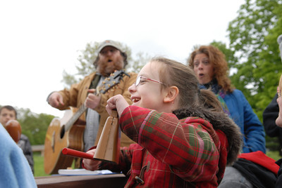 Danville Primary School first grader Lexi Ashton, 8, plays the cowbell along side musician Wes Fahringer at a end of year picnic for Life Skills and autistic students at the PPL Montour Preserve on Monday afternoon.