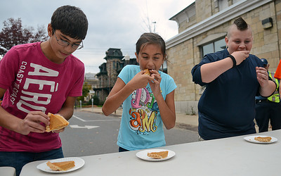 Rosario Cracchiolo, 13, Taylor Haas, 9, and Londyn Wesman, 10, all of Danville, compete in the kid's pie eating contest at the Pumpkin Palooza in Danville on Saturday afternoon. Wesman ate two peices of pie the fastest to win the contest.