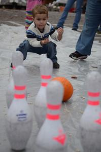 Nicholas Kessler, 2 of Danville, uses a pumpkin to bowl.