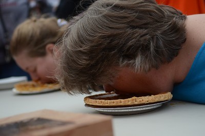 Christ Berkheimer, of Danville, right, and Ruth Passmore, of Muncy, left, participate in the adult pie eating contest.