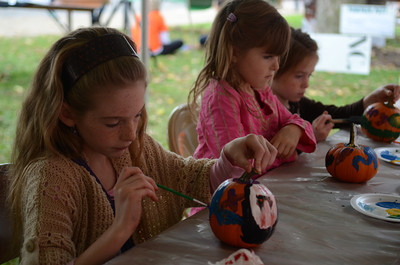 Coyla Bartholomew, 9 of Danville, and her sisters Victoria, 6, and Hannah, 6, paint pumpkins.