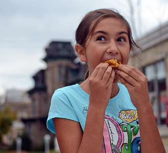 Taylor Haas, 9 of Danville, participates in the kid's pie eating contest at Pumpkin Palooza in Danville on Saturday afternoon. Londyn Wesman, 10 of Danville, not pictured, won the contest by eating two pieces of pie the fastest.