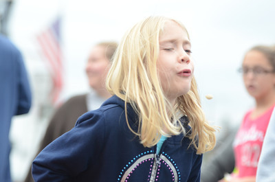 Jaiden Wendt, 7 of Dalmatia, participates in the Pumpkin Seed Spitting Contest.
