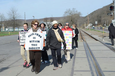 Danville teachers picket outside the Danville Middle School on Thursday morning.