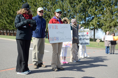 Danville Area School district teachers stand in the driveway at the Liberty Valley Intermediate School on Thursday morning as they were out on strike.
