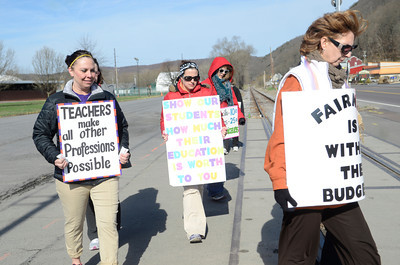 Danville Area School district teachers Lorie Flatley, left, and Ann Marie Cantore, right, picket along side fellow teachers outside the Danville Middle School on Thursday morning.