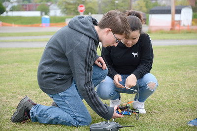 Danville Middle School students Michael Holmes, 14, left, and Amani Mundrick, 13, check over their group's drone before testing it out on Wednesday.