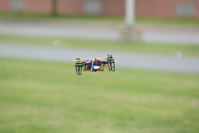 A drone flies through the air behind the Danville Middle School as part of a STEM class project on Wednesday.