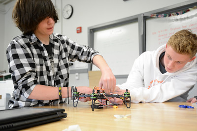 Danville Middle School students Jacob Nelson, 15, left, and Austin Heeter, 14, work together in assembling a drone during their STEM class on Wednesday.