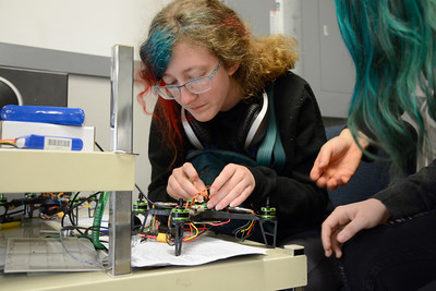 Danville Middle School student Amber Carew, 14, tweaks the wiring in her groups drone during a STEM class on Wednesday.