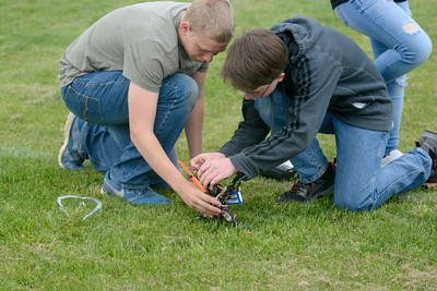 Blake Keefer, 14, left, and Michael Holmes, 14, work on their groups drone outside the Danville Middle School on Wednesday where they were trying to get it to fly.