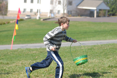 Clayton Davis, 7, chases down eggs at Saturday's Easter egg hunt at Grandview Health Homes in Danville.