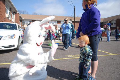 Morgan Beck, 1, and Mandy Hackenberg, 10, say hi to the Easter Bunny at Saturday's egg hunt at Grandview Health Homes.