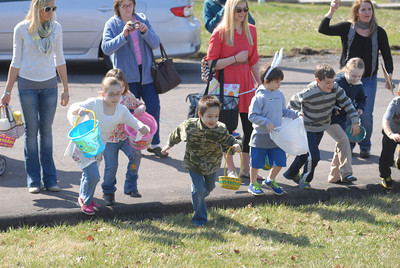 Kids take off at the start of the egg hunt on Saturday at Grandview Health Homes in Danville.