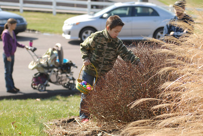 Van Soltis, 7, finds eggs in a bush at Saturday's Easter egg hunt at Grandview Health Homes in Danville.