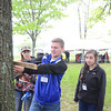 Northumberlan Christian School students Larissa Hummel, 17, left, Ryan King, 19, and Kylis Mahaffey, 15, measure a tree at the PPL Montour Preserve on Wednesday afternoon during the Envirothon.