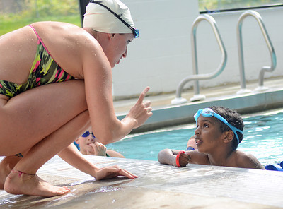 U.S. Olympian Claire Donahue coaches Henok Yohannes, 6 of Danville, on his freestyle strokes during the Fitter and Faster Swim Tour at the Danville Area Community Center on Saturday afternoon.