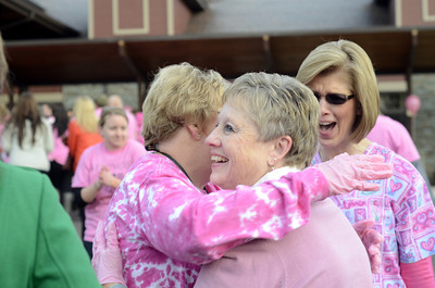 Annette Blessing, left, gives Cindy Bird a hug along side Rondi Shuey on Friday outside Geisinger after it was announced that Geisinger won a national pink glove video competition.