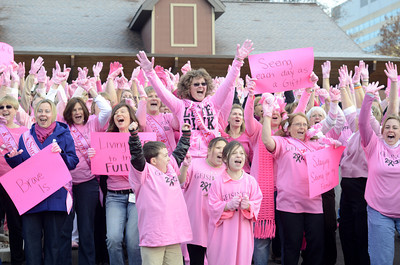 Participants in Geisinger's pink glove video cheer after they found out they won a national competition on Friday.