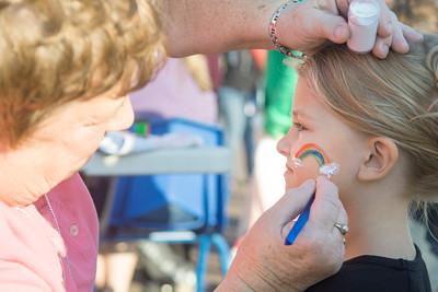 Danville Head Start teacher Nancy Everly, left, paints the face of Anistyn Kurzawa, 5, of Danville, during a celebration for the Danville Head Start on Thursday.