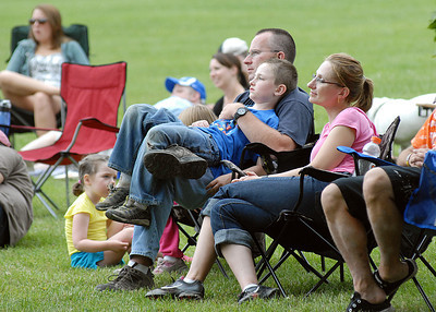 Bob Stoudt, director of Montour ARea Recreation Commission, sits with his wife, Becky and son, Brian, 6, during Van Wagner's performance at the Hess Fest Saturday June 9, 2012.