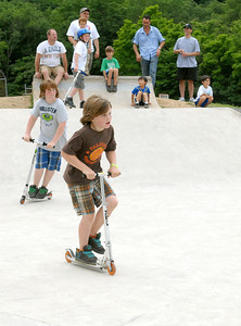 Brothers, Brock, 12, and Teeg Tate, 8, of Lewistown take a turn during the free skate at Hess Fest in Danville Saturday June 9, 2012.