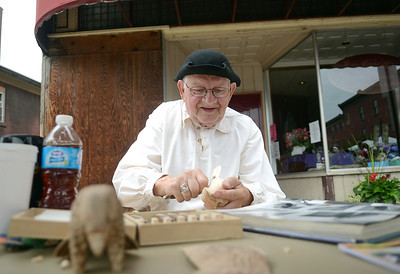 Maynard Gearhart of Williamsport clears out extra wood before adding details to his next bird Saturday during the Saturday celebrations at Danville's Iron Heritage Festival.