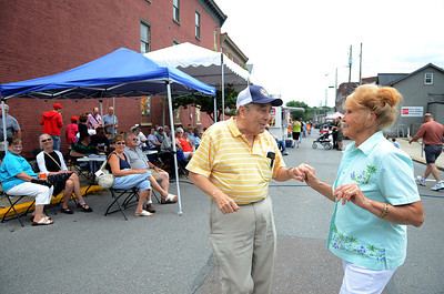 Ed DeGreen of Danville and Marie DeWald of Riverside take a turn on the dance floor during one of the music performances on Mill Street during the Iron Heritage Festival Saturday July 21, 2012.