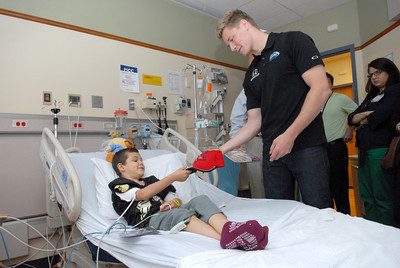 Gage Campbell, left, Catawissa, gets a signed hat from Indy car driver Josef Newgarden on Friday at the Janet Weis Children's Hospital in Danville through the Racing For Kids charity.